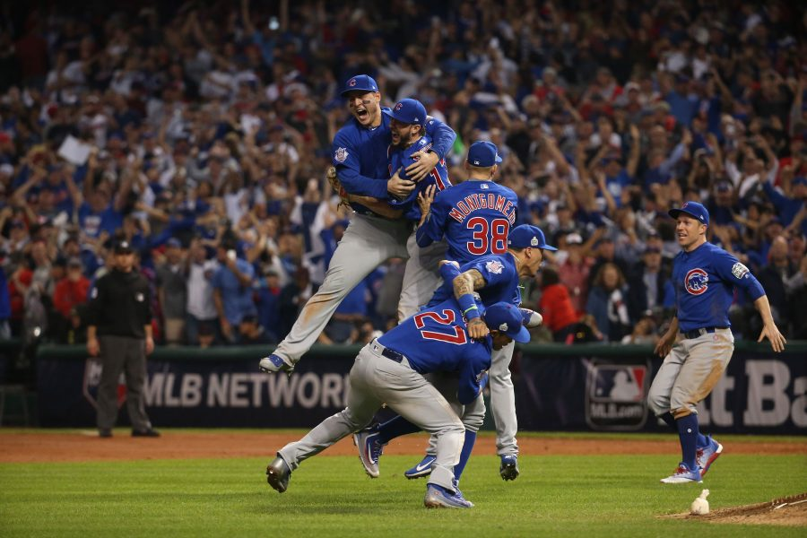 The Chicago Cubs celebrate after defeating the Cleveland Indians, Nov. 3, 2016 in Game 7 to win the World Series 8-7 at Progressive Field in Cleveland, Ohio.