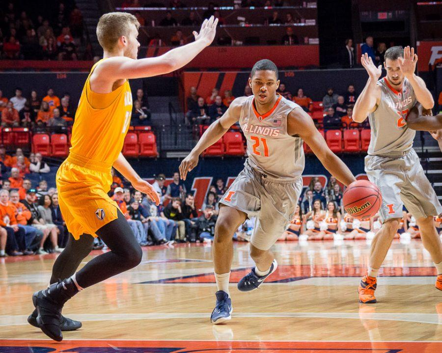 Illinois%27+Malcolm+Hill+%2821%29+drives+to+the+basket+during+the+game+against+Valparaiso+at+State+Farm+Center+on+Tuesday%2C+March+13.