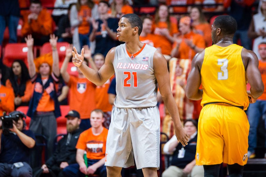 Illinois' Malcolm Hill (21) celebrates after knocking down a three-point shot against Valparaiso at State Farm Center on Tuesday, March 13.