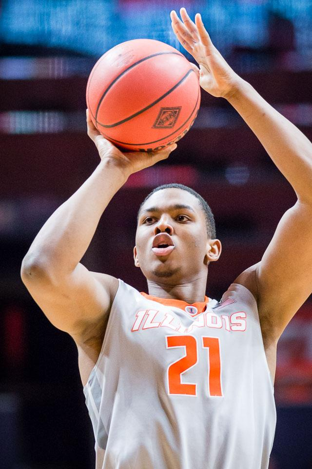 Illinois' Malcolm Hill (21) shoots a three against Valparaiso at State Farm Center on Tuesday, March 13.
