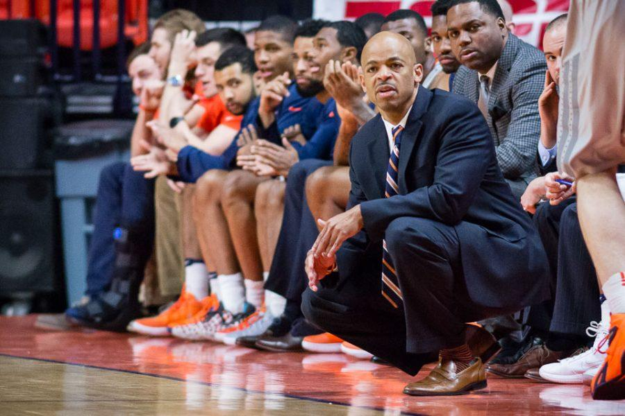 Illinois interim head caoch Jamall Walker watches his team from the sideline during the game against Valparaiso at State Farm Center on Tuesday, March 13.