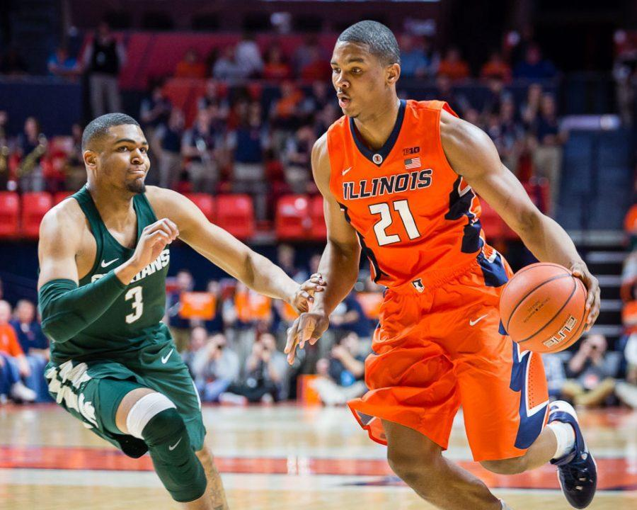 Malcolm Hill drives to the basket during the game against Michigan State on March 1. Columnist Matt Gertsmeier says that though the Illini could use a fresh start, they could still have a chance in their must-win game against Michigan.
