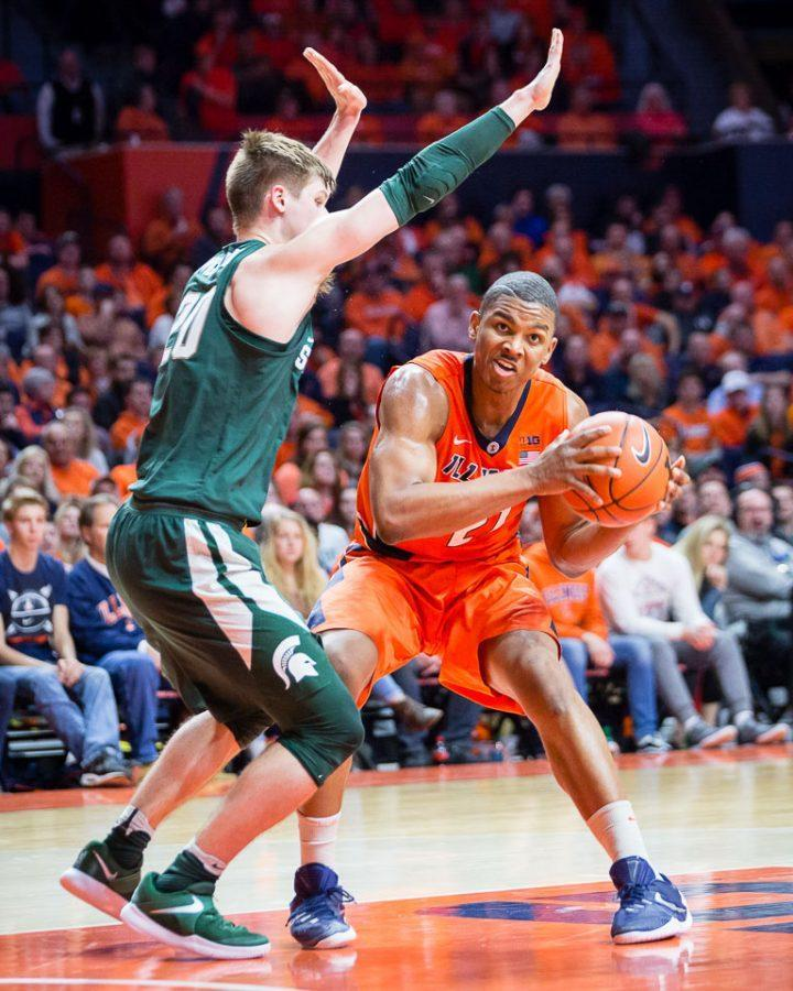 Illinois' Malcolm Hill (21) drives to the basket during the game against Michigan State at State Farm Center on Wednesday.