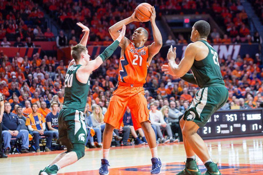 Illinois' Malcolm Hill (21) pulls up for a jumper during the game against Michigan State at State Farm Center on Wednesday, March 1.