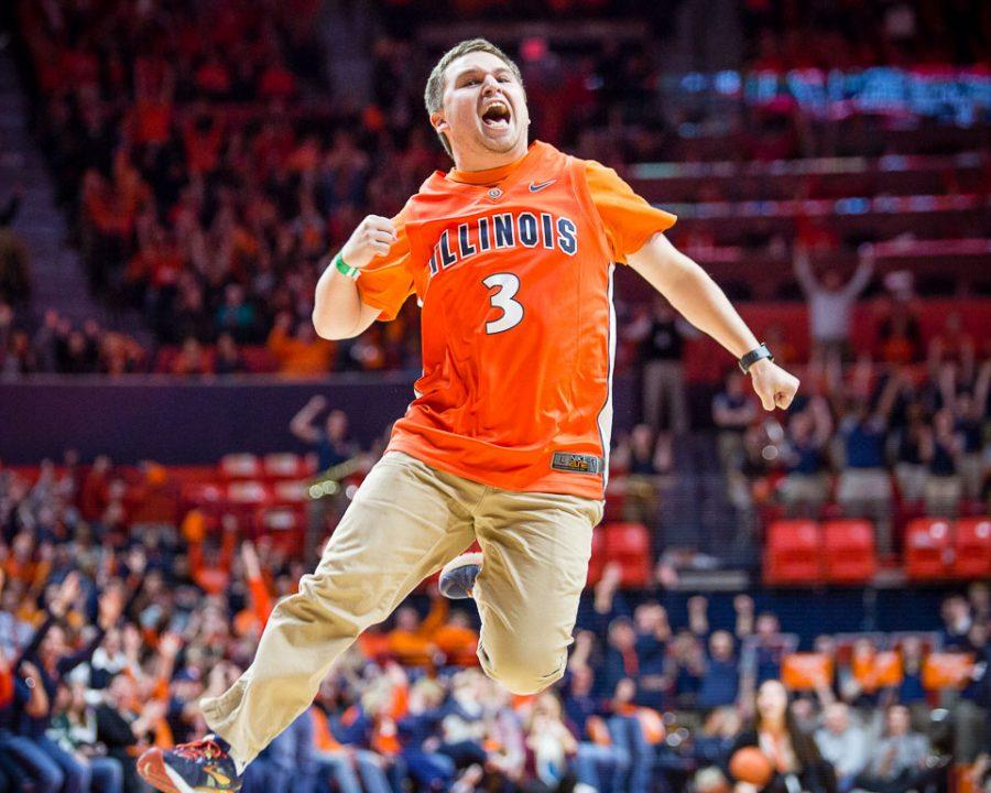 Illinois student Drake Kurtenbach celebrates after hitting a shot from half court to win ten thousand dollars during a break in the game against Michigan State at State Farm Center on Wednesday, March 1.