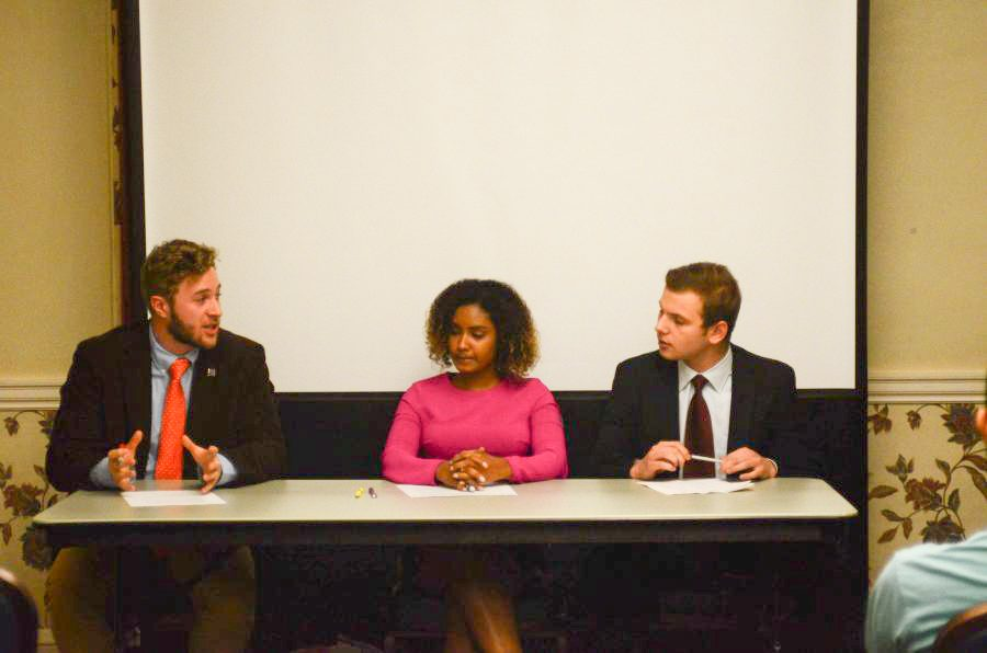 The candidates for student government, Bobby Knier, Raneem Shamseldin and Jesse Tabak, face off in a debate at the Illini Union room 209 on Monday, March 6th.