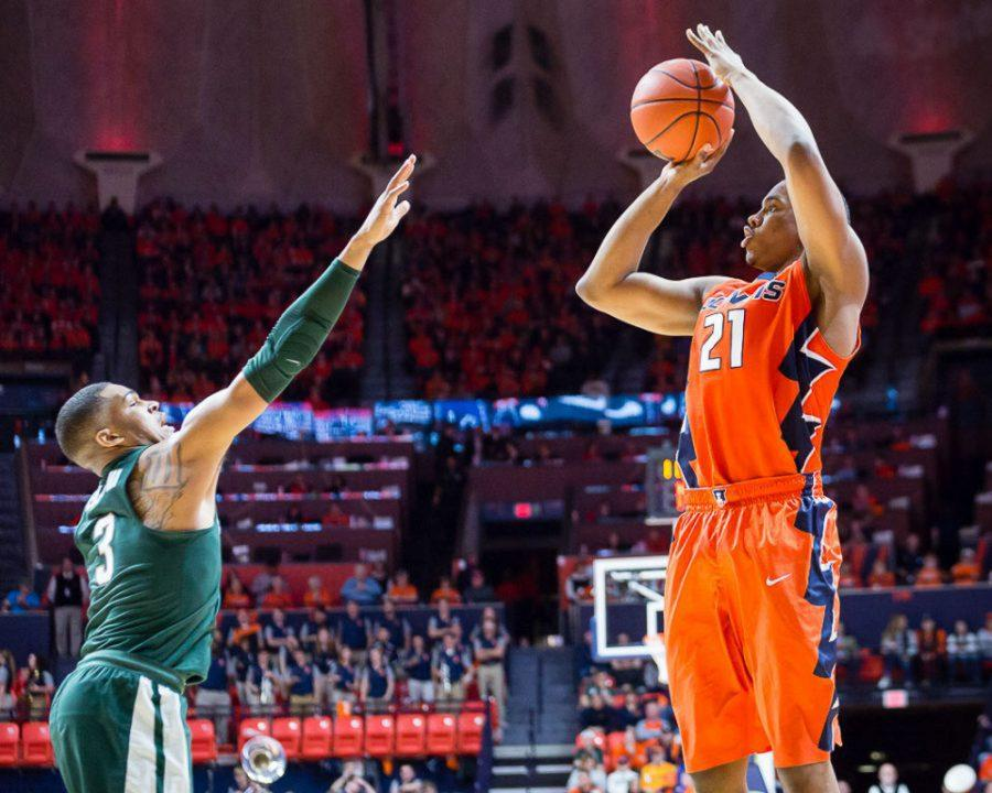 Illinois' Malcolm Hill (21) shoots a three during the game against Michigan State at State Farm Center on Wednesday, March 1.
