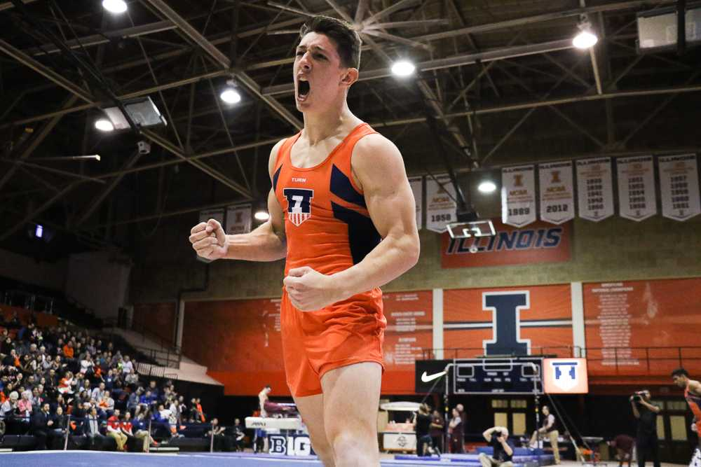Sebastian Quiana celebrates after a strong performance on the floor in the meet against Minnesota on Jan. 28.