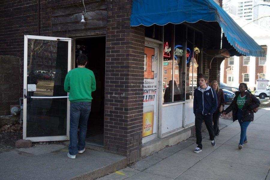 Students walk past the Illini Inn on Unofficial St. Patricks Day.