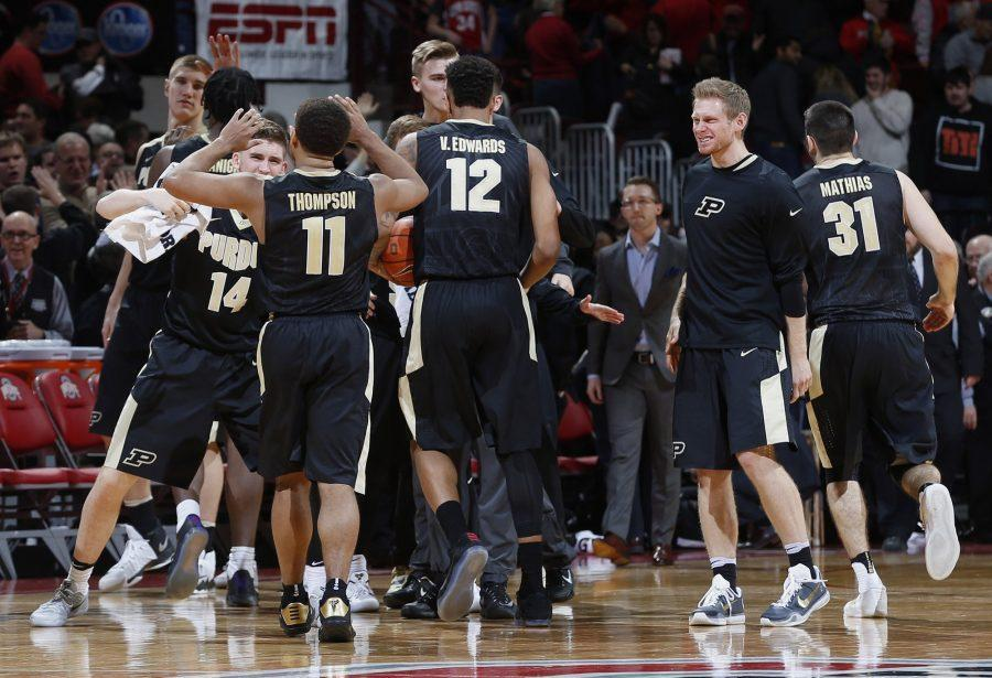 The Purdue Boilermakers celebrate a 76-75 win against Ohio State at Nationwide Arena in Columbus, Ohio, on Thursday, Jan. 5, 2017. (Brooke LaValley/Columbus Dispatch/TNS)