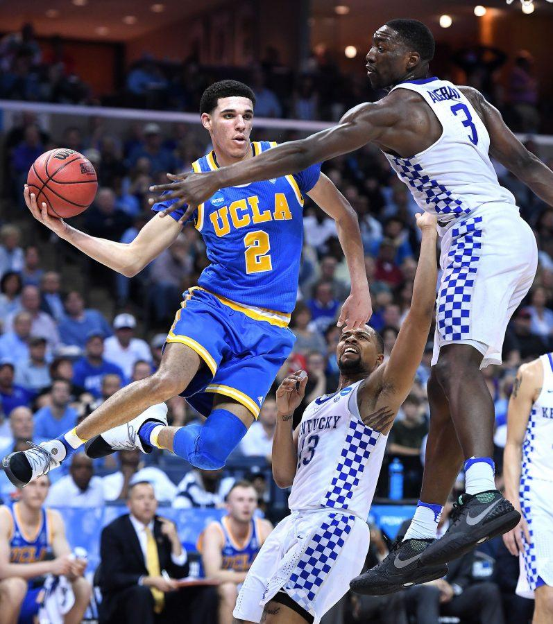 UCLA's Lonzo Ball (2) gets a pass off in front of Kentucky's Isaiah Briscoe, middle, and Edrice Adebayo in the second half during an NCAA Tournament South Regional semifinal at FedExForum in Memphis, Tenn., on Friday, March 24, 2017. Kentucky advanced, 86-75. (Wally Skalij/Los Angeles Times/TNS)