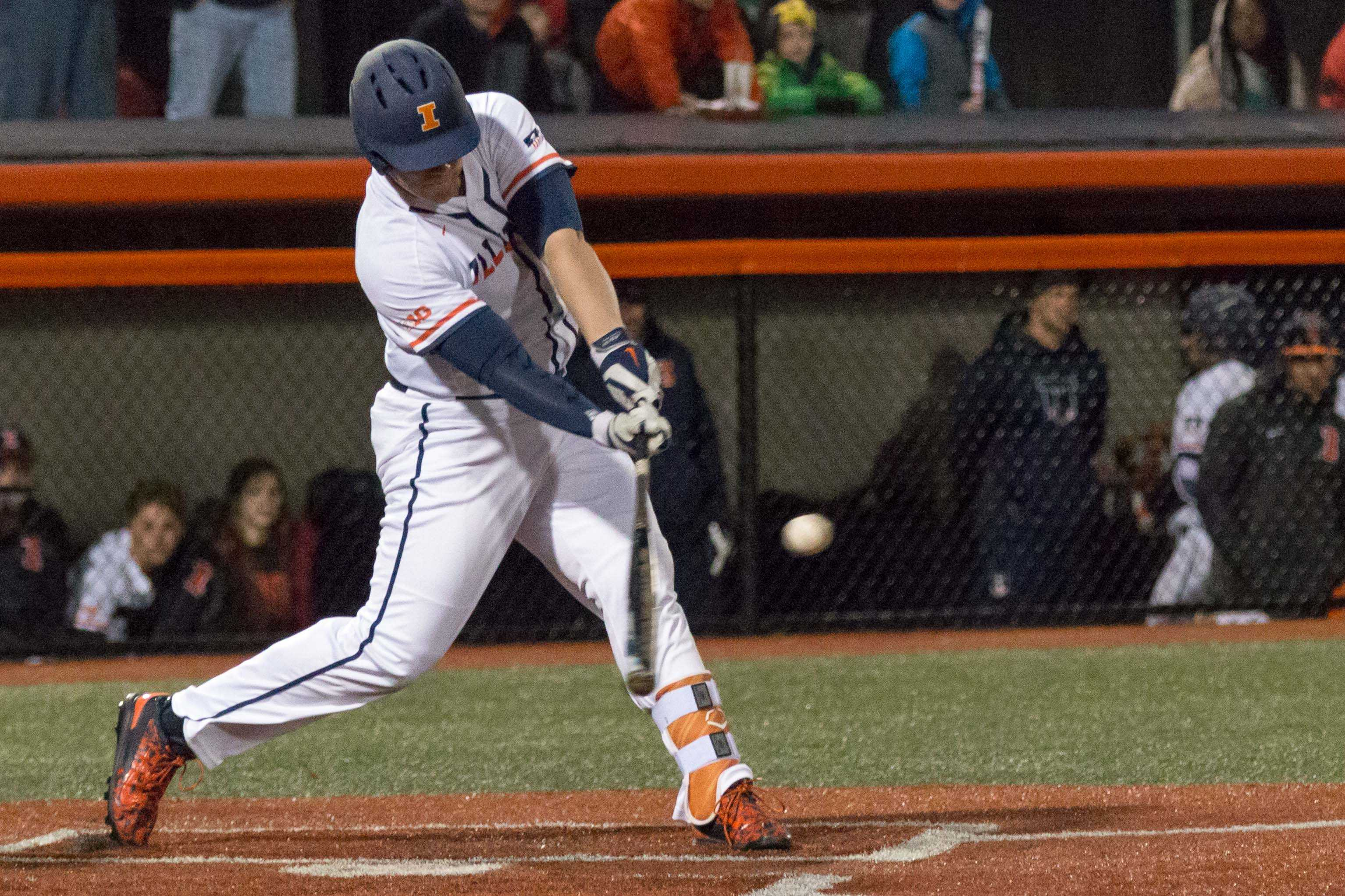 Illinois' Luke Shilling hits a double down the right field line scoring Pat McInerney in the game against Eastern Illinois at Illini Field on Tuesday, April 5. The Illini won 9-7.