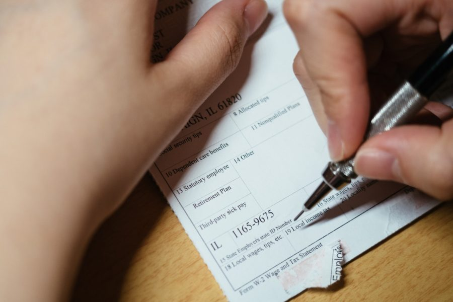 A student fills out the W-4 tax form.