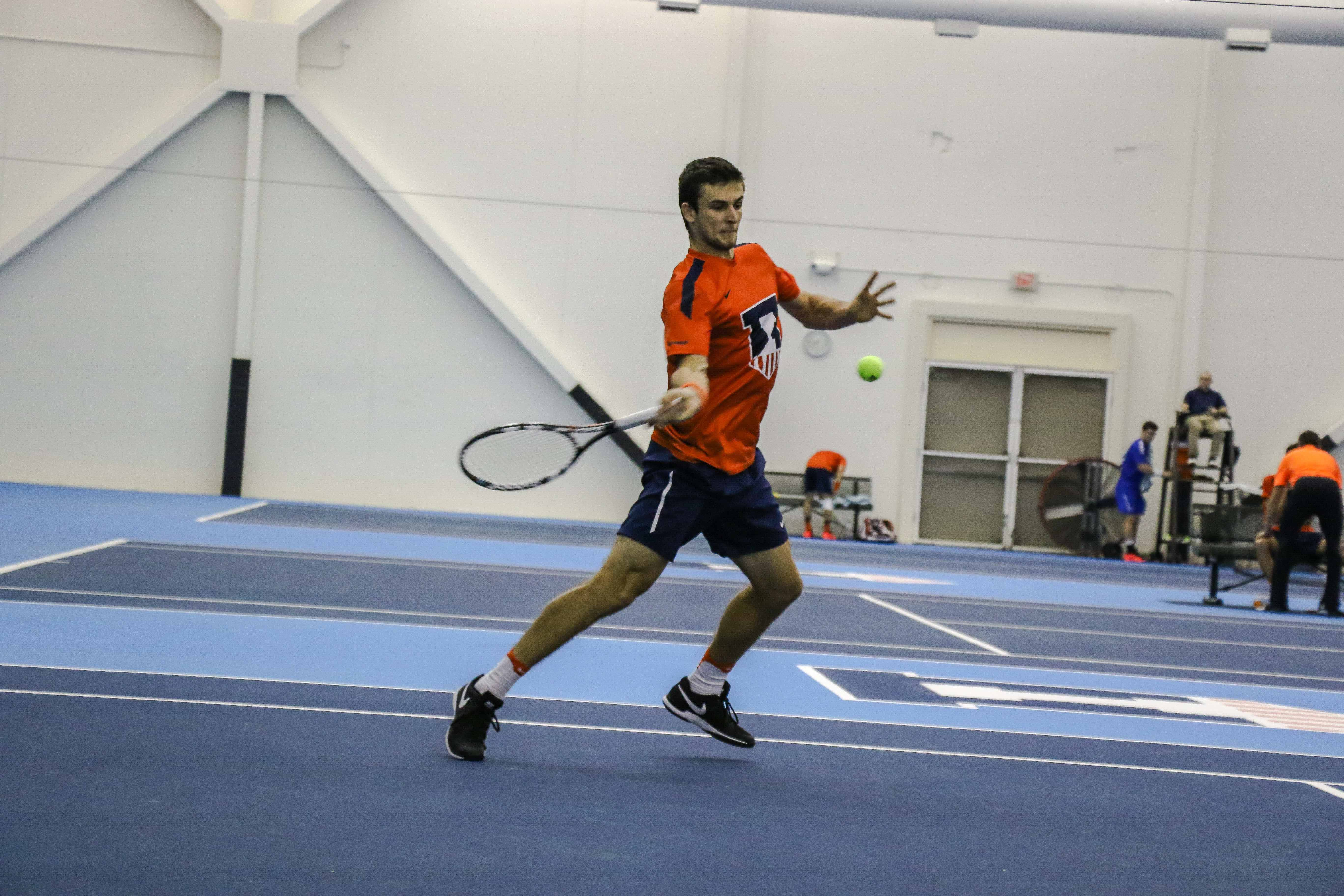 Illinois'  Aleks Vukic strikes back the ball in the meet against University of Kentucky on Friday, Feb. 24 at the Atkins Tennis Center in Urbana.