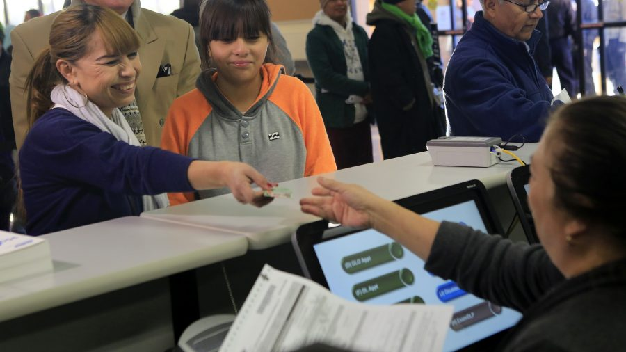Sonia Sorino, left, with daughter Kelya, 12, right, was first in line to fill out paperwork for her California driver license at DMV offices on Friday, Jan. 2, 2015 in Granada Hills, Calif. (Brian van der Brug/Los Angeles Times/TNS)