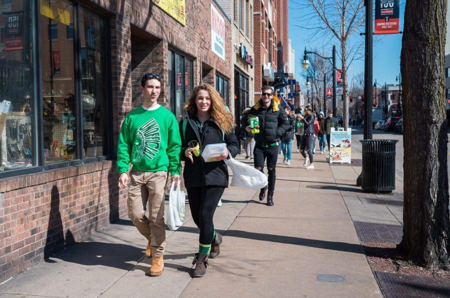 People in green outfits walking down the Green Street on Unofficial St.Patrick's Day, Mar. 3, 2017.
