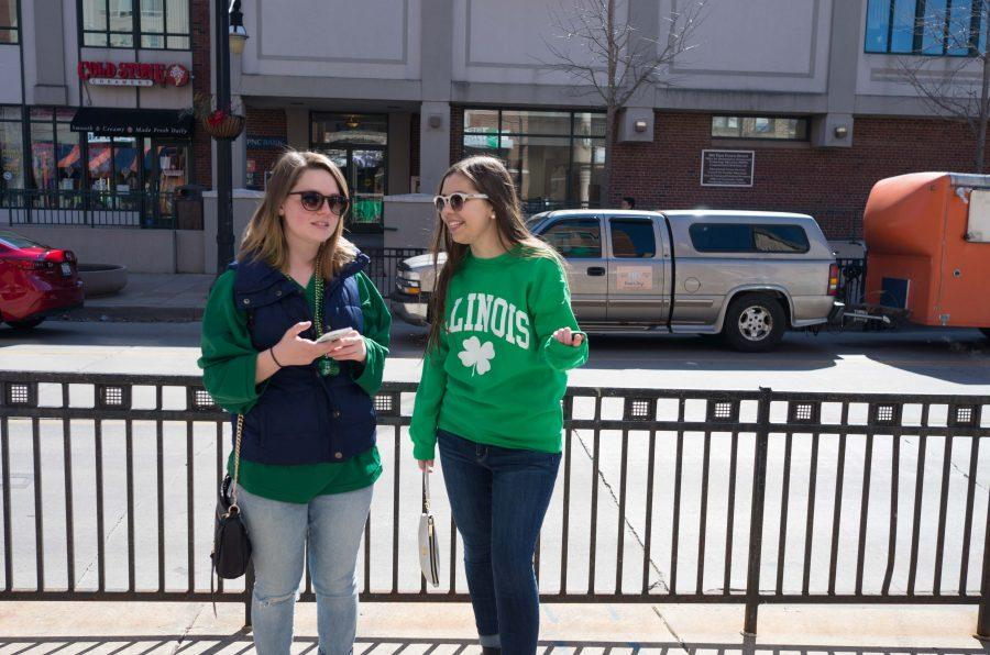 People in green outfits chatting on Green Street on Unofficial St.Patricks Day, Mar. 3, 2017.