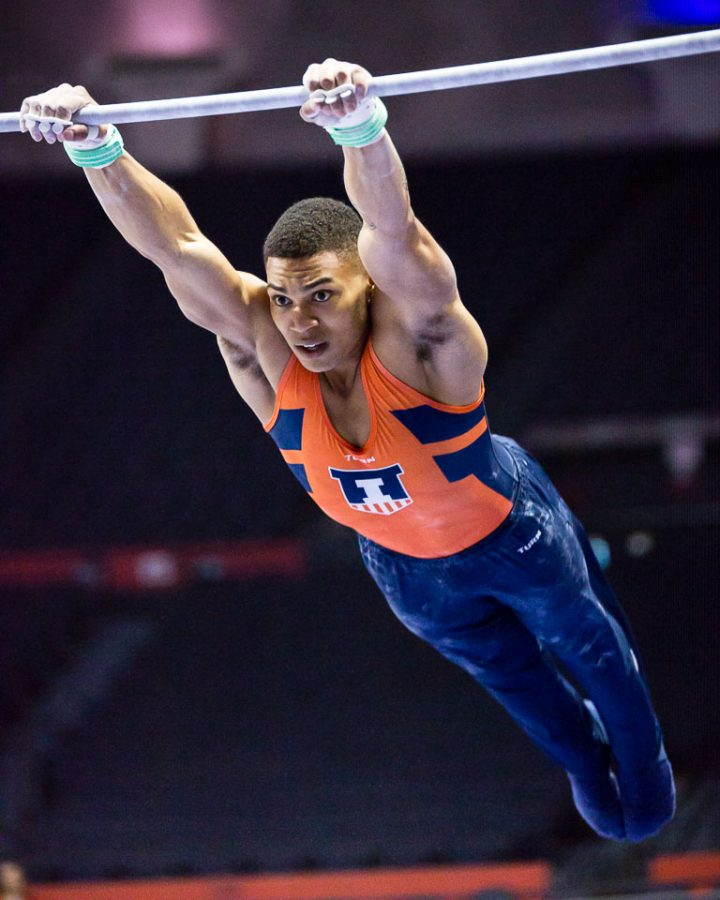 Illinois' Chandler Eggleston performs on the high bar during the Men's Big Ten Gymnastics Championships at the State Farm Center on April 7, 2017.