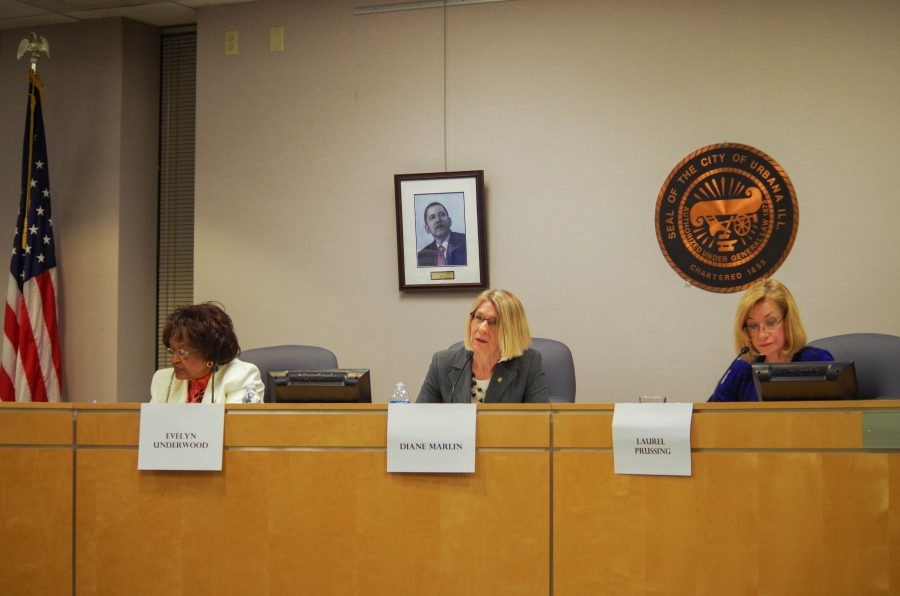 The mayoral debate for Urbana that took place at the Urbana City Council Chambers on Monday, Jan. 30th. Diane Marling (center) was announced mayor of Urbana, defeating incumbent Laurel Pressing (right) in the election.