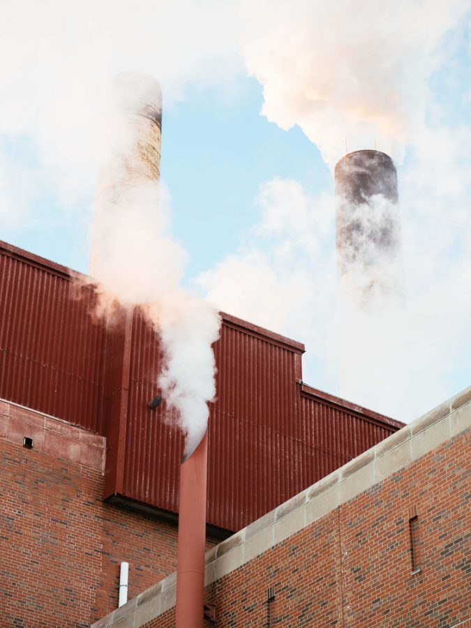 Water vapor comes out of the Abbott power plants main chimneys.