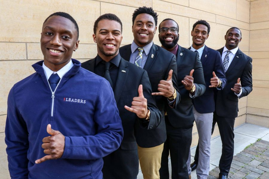 Alpha Phi Alpha fraternity poses in front of the BIF on April 10.
