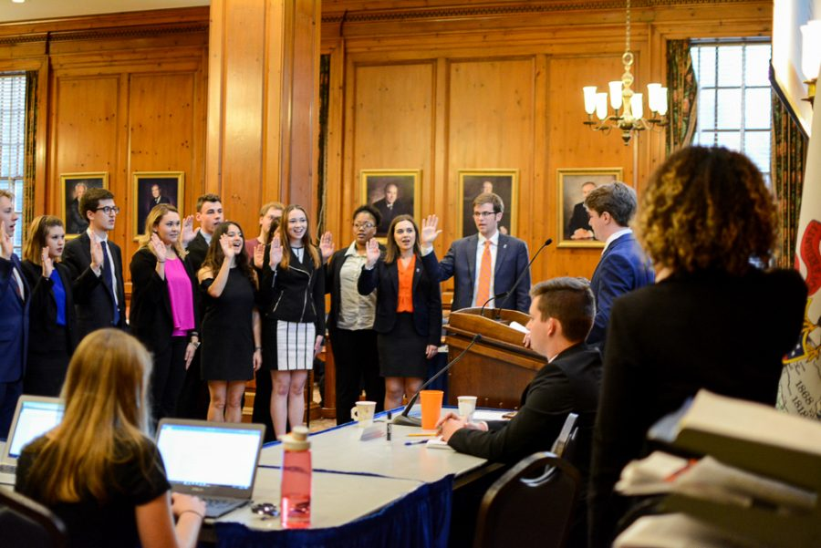 The+new+Illinois+Student+Government+officers+are+sworn+in+at+the+Illini+Union+Pine+Room%2C+excluding+the+new+student+trustee.+The+student+trustee+election+will+be+held+on+April+27.+It+was+rescheduled+because+one+student%E2%80%99s+name+was+left+off+the+ballot+during+the+initial+election.