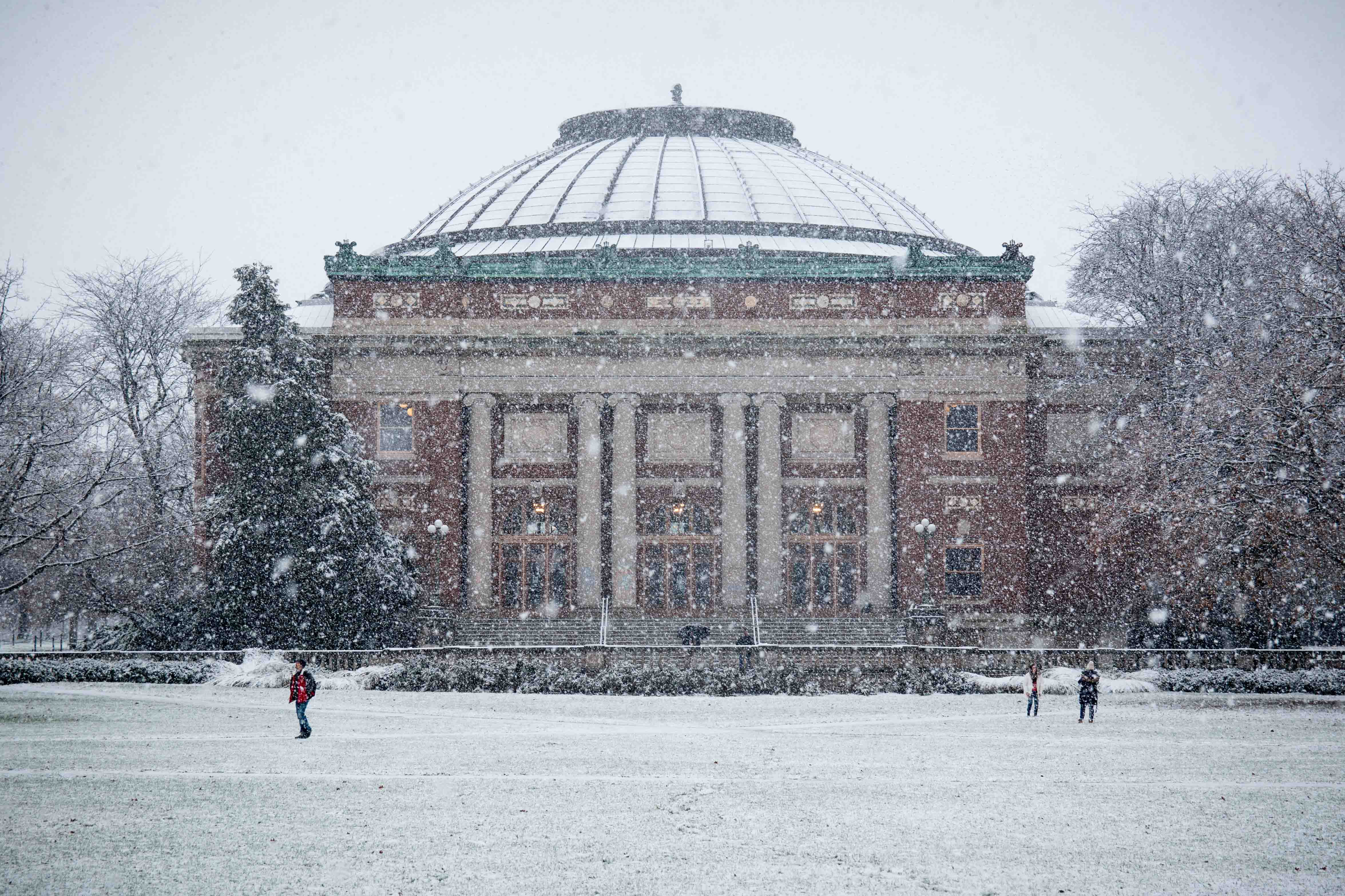 Foellinger Auditorium in the snow on Dec. 4. While living in the Midwest, it's important to know what is appropriate to wear during which season, writes brand manager Brooke.