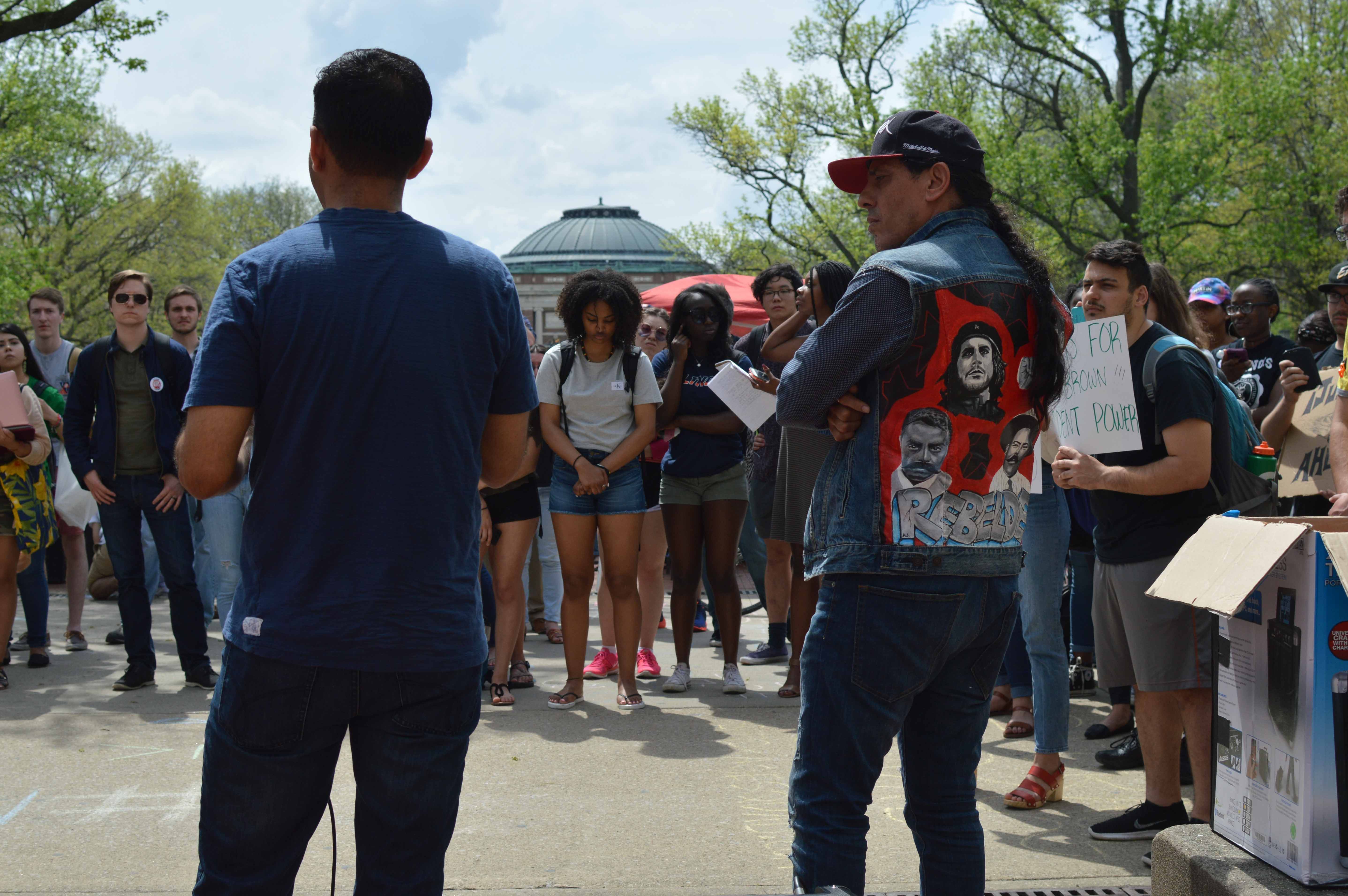 Julio Villegas and Chuy Chavez, an original protester from 1992, speaks at a rally on the Main Quad on Wednesday. Students gathered to protest and voice demands originally made in 1992. Columnist Tatiana Rodriguez hopes the University will listen to protester's demands.