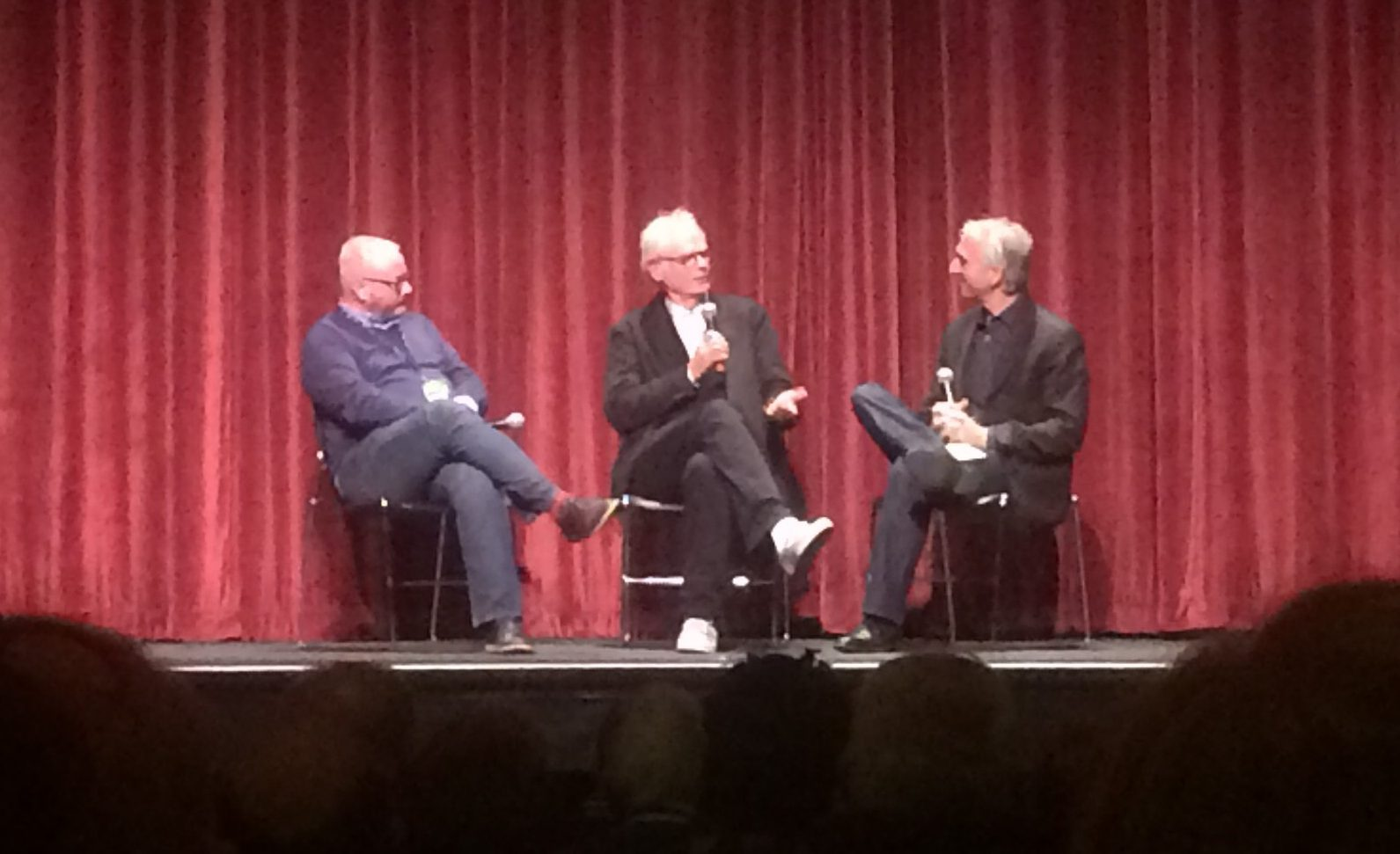 "Nate Cohn (left) listens as Caleb Deschanel recounts working as a cinematographer on the 1979 film, ""Being There."" Deschanel at first denied political themes for the movie, but he later admitted to the film's prevalent power and political motifs."