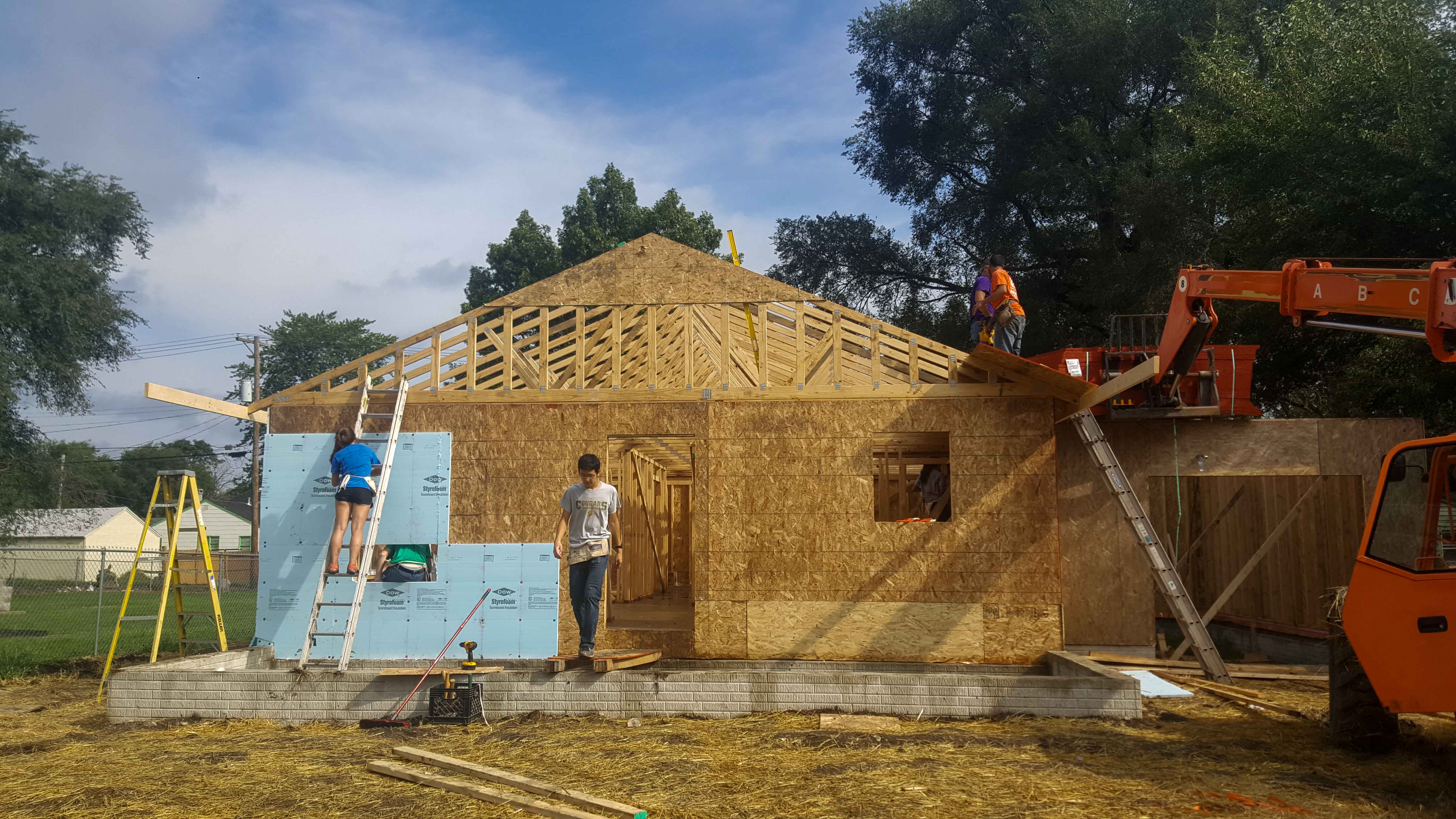 The UIUC Habitat for Humanity chapter and volunteers work on the blitz build of 506 Columbia. The organization is currently working on building its 100th home.