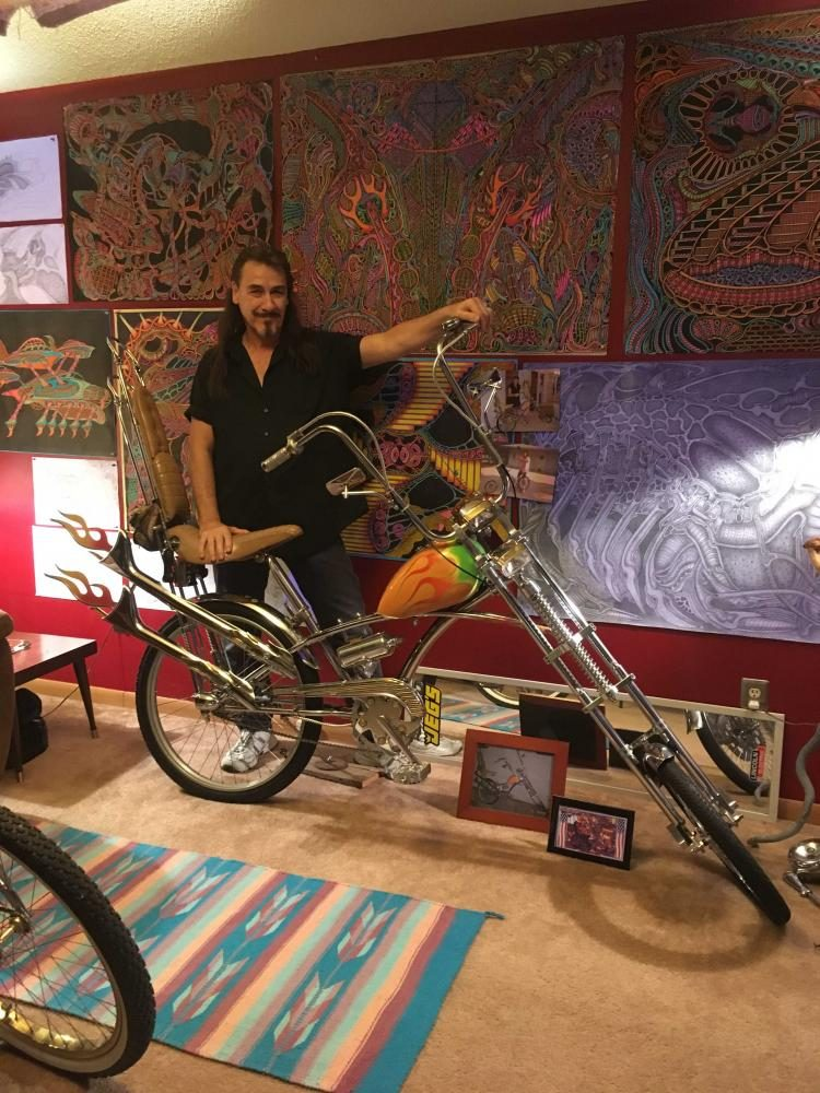 Mark+Roberts%2C+an+Urbana+resident%2C+with+one+of+the+many+bicycles+that+he+creates.+Roberts+showcases+his+artistic+ability+through+his+bikes%2C+as+well+as+his+collection+of+sketches+and+paintings.+