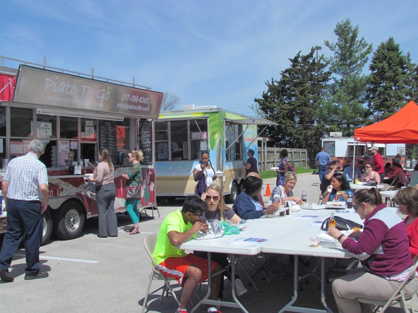 Food+Trucks+parked+at+the+Urbana+Food+Truck+Rally+on+Tuesday+at+the+Urbana+Civic+Center.+The+Urbana+Food+Truck+rally+takes+place+on+the+last+Tuesday+of+every+month+from+now+until+late+October.+