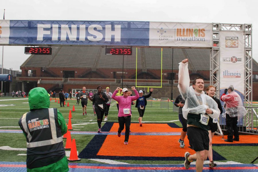 Runners+cross+the+finish+line+in+the+Christie+Clinic+Illinois+Marathon+at+Memorial+Stadium+in+April+2016.+The+annual+Illinois+Marathon+will+take+place+this+weekend.