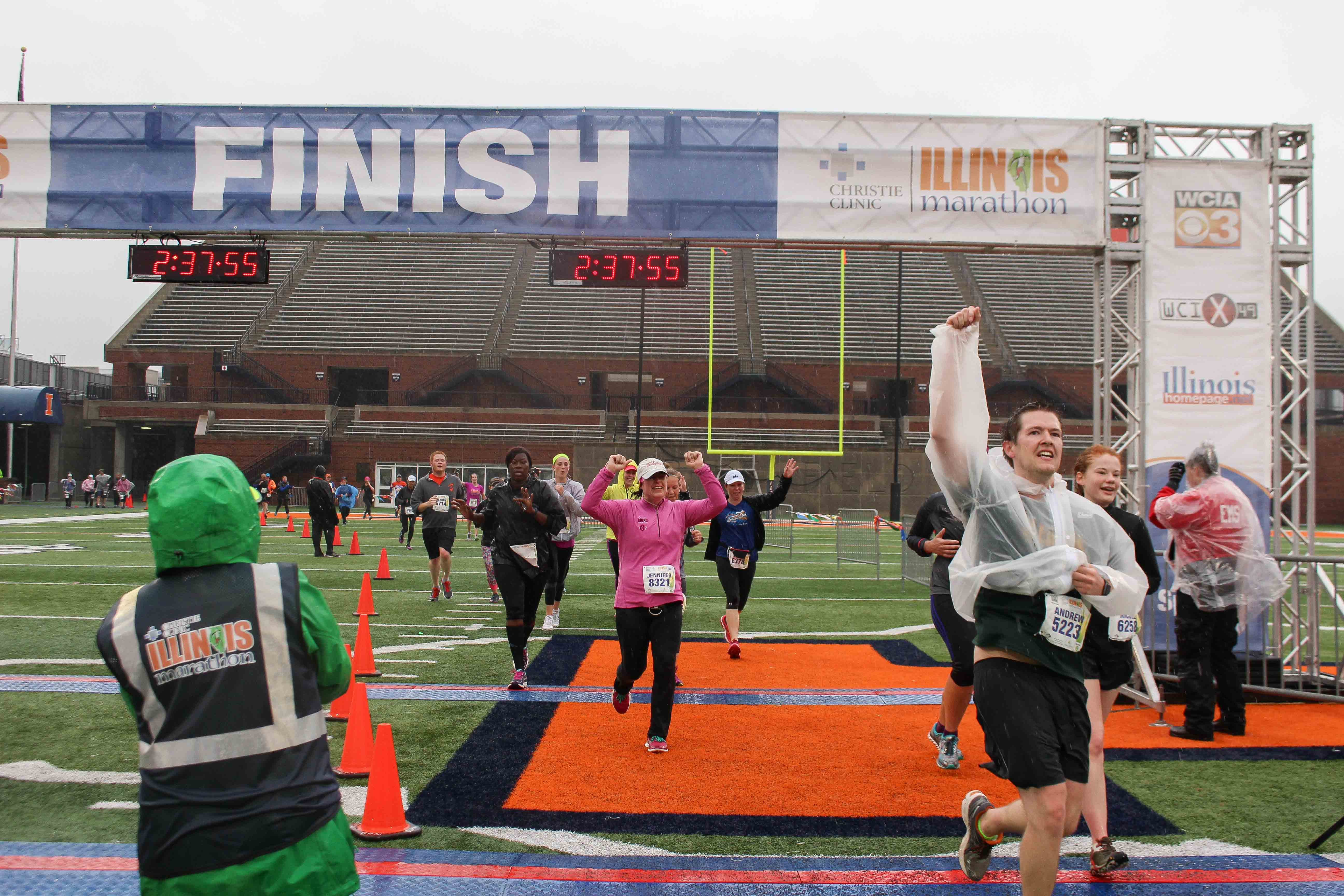Runners cross the finish line in the Christie Clinic Illinois Marathon at Memorial Stadium in April 2016. The annual Illinois Marathon will take place this weekend.