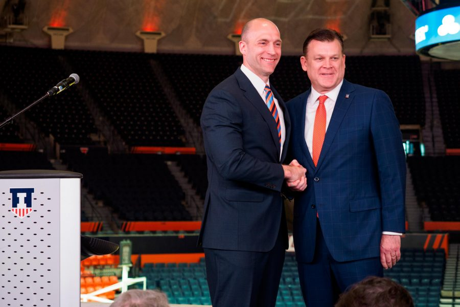 Josh Whitman introduces new men's basketball coach Brad Underwood during a press conference March 20. Underwood now has his first recruit signed, Mark Smith.