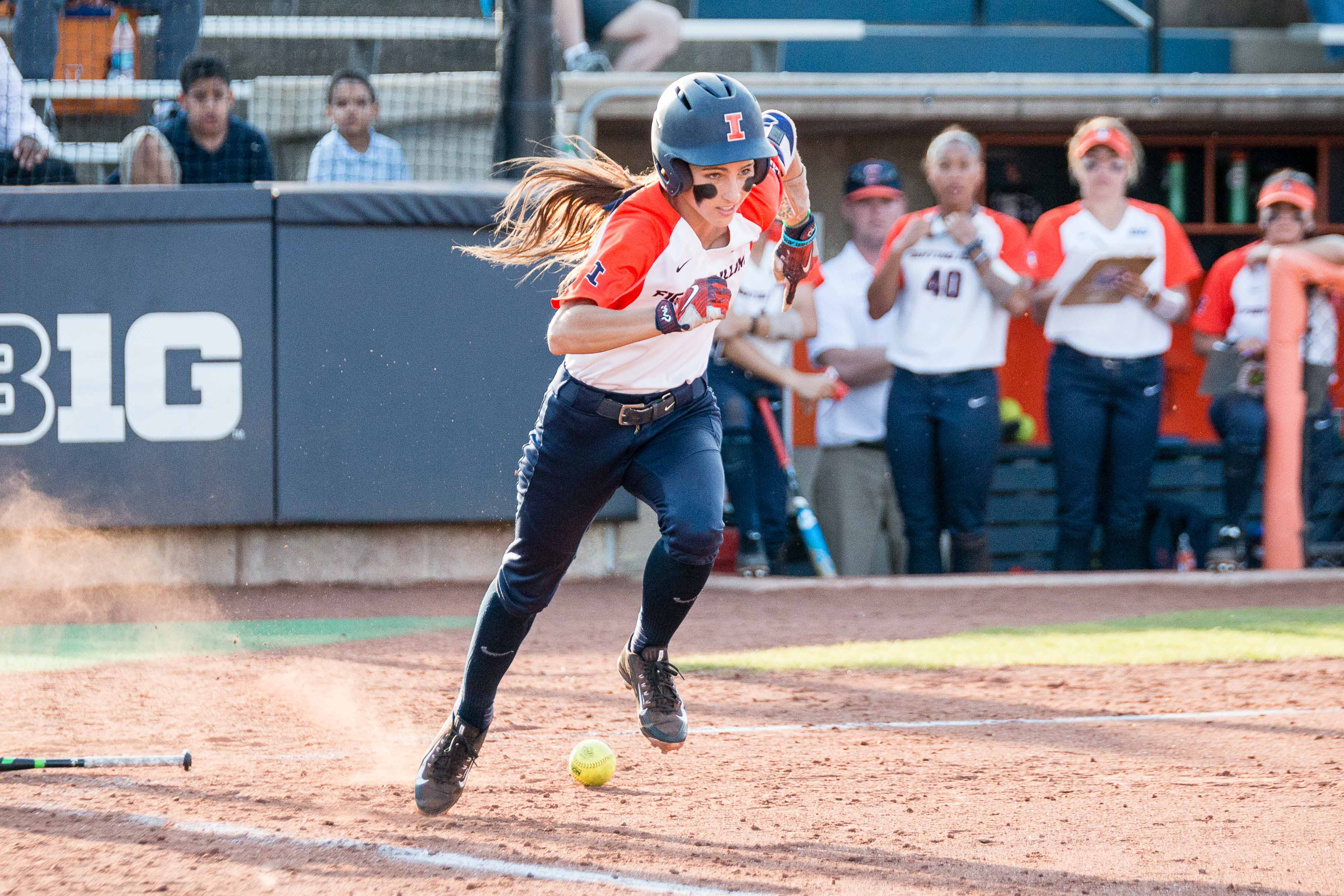 Illinois' Leigh Farina sprints to first after putting down a bunt against Butler at Eichelberger Field on Wednesday. Farina earned Illini of the Week honors after her performance against Michigan State last weekend.