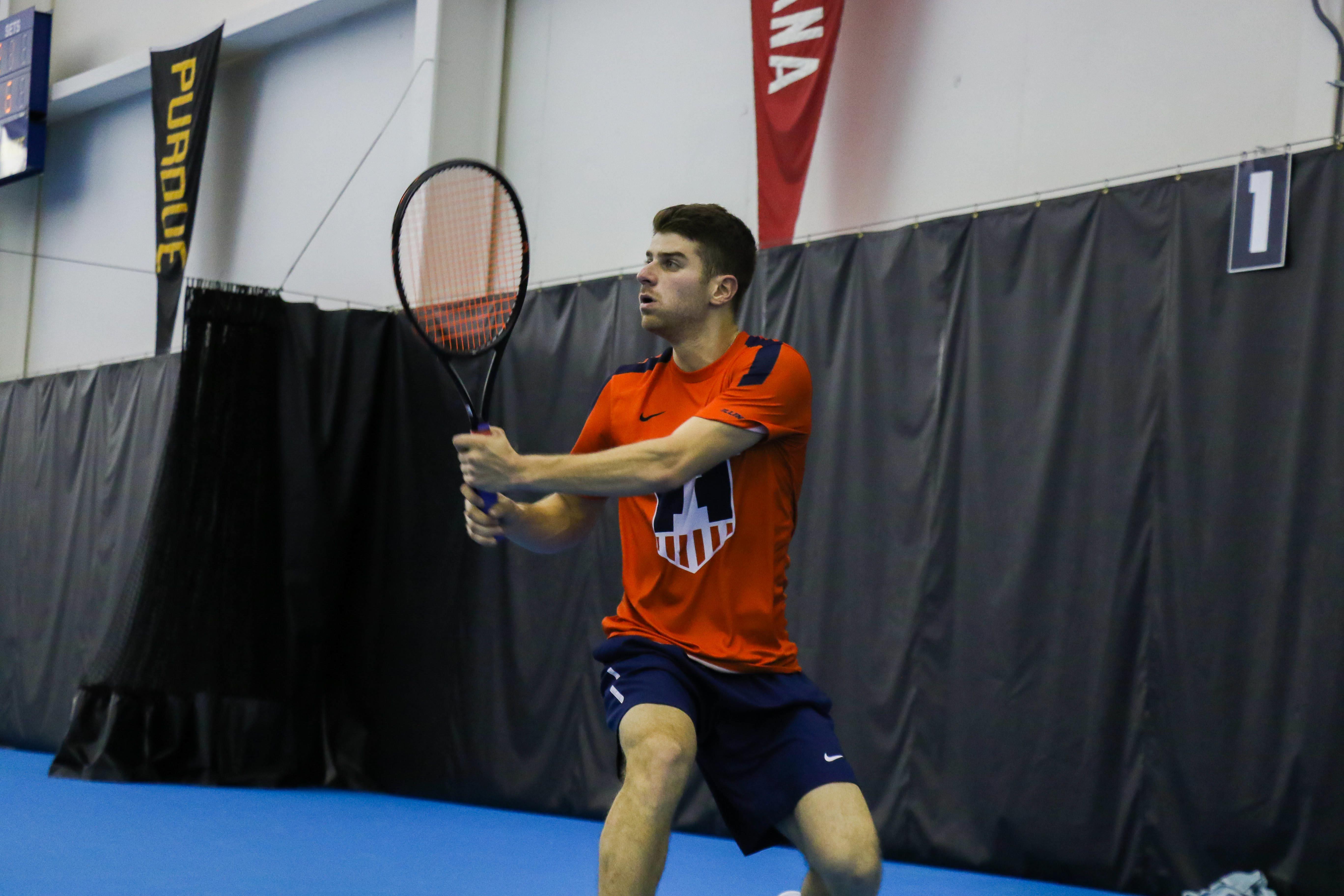 Illinois' Aron Hiltzik follows through on a swing in the meet against University of Kentucky on Friday, Feb. 24 at the Atkins Tennis Center in Urbana.