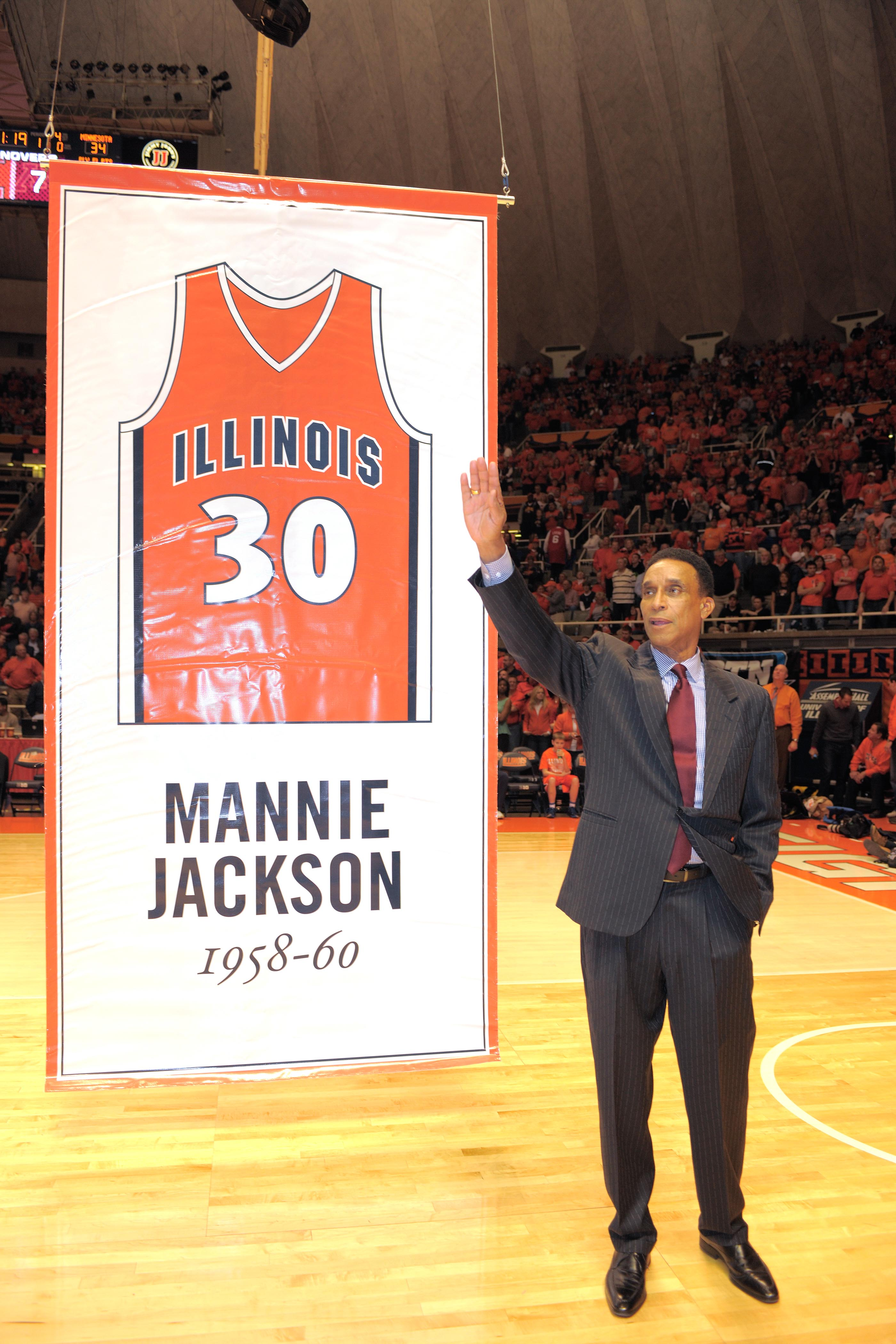 Former Illini Mannie Jackson is honored by having his jersey retired at Assembly Hall in 2013. Jackson was one of the first African-Americans to letter and start in basketball at Illinois. This September, he will be inducted into the Basketball Hall of Fame in the Class of 2017 along with nine other former stars.