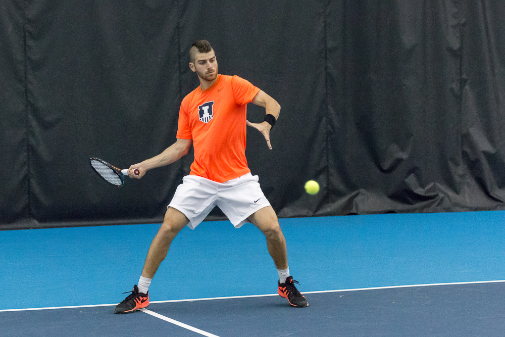 Illinois' Aron Hiltzik gets ready to return a ball against Wisconsin at the Atkins Tennis Center on April 3.