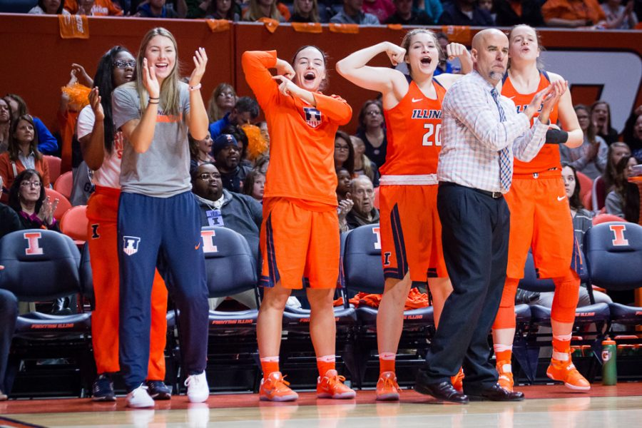 Illinois' Meagan McNicholas (center) cheers on her team from the sideline during the game against Indiana at State Farm Center on Saturday, February 25.