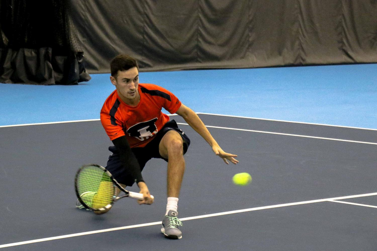 Illinois%27+Alex+Jesse+goes+low+to+return+the+ball+in+the+match+against+University+of+Kentucky+on+Friday%2C+Feb.+24+at+the+Atkins+Tennis+Center+in+Urbana.