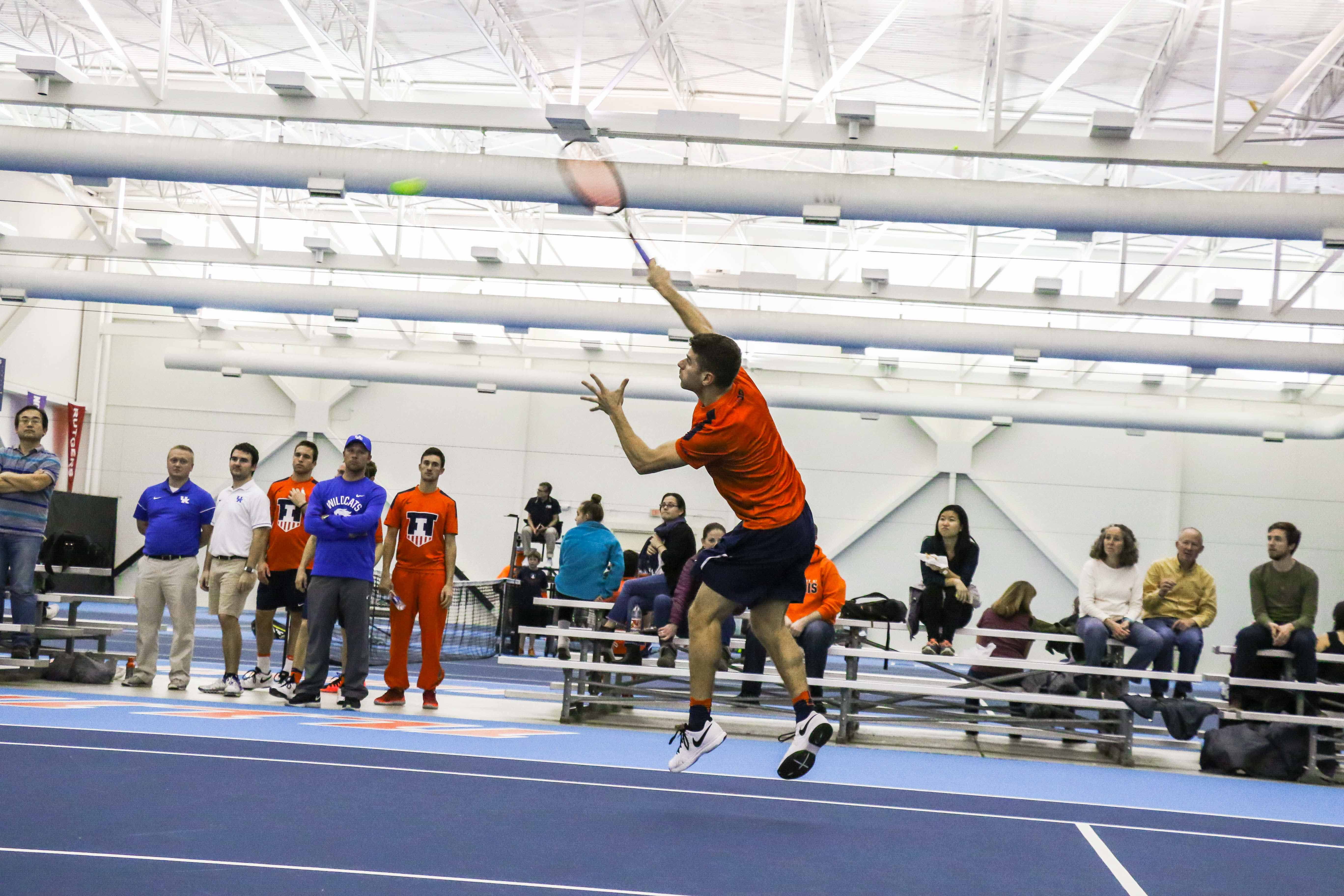 Illinois' Aron Hiltzik hits an overhead against Kentucky on Feb. 24 at the Atkins Tennis Center. The Illini take on Penn State and Ohio State this weekend. While the team has been inconsistent this season, it is currently riding a winning streak.