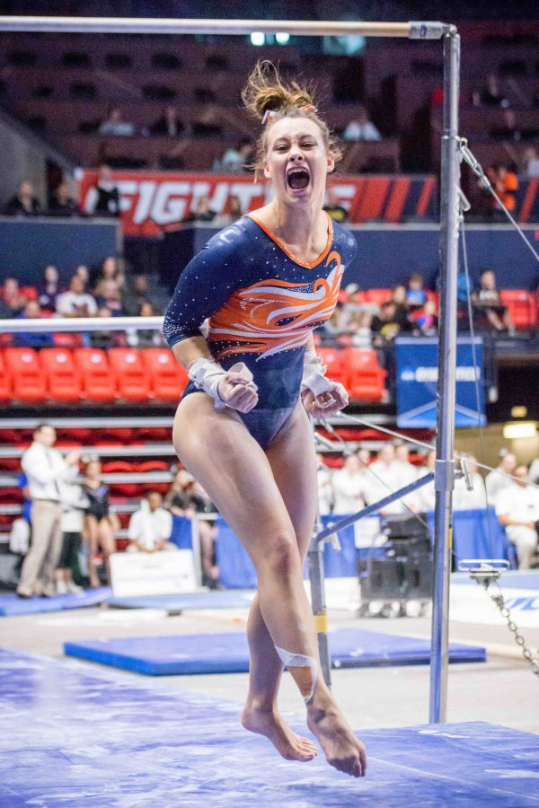 Illinois' Sarah Lyons celebrates after her performance on the uneven bars during the NCAA Regional at the State Farm Center on Saturday. The Illini placed fourth as a team with a score of 195.875. It was a close competition, with Illinois battling with Oregon on the vault for third place.