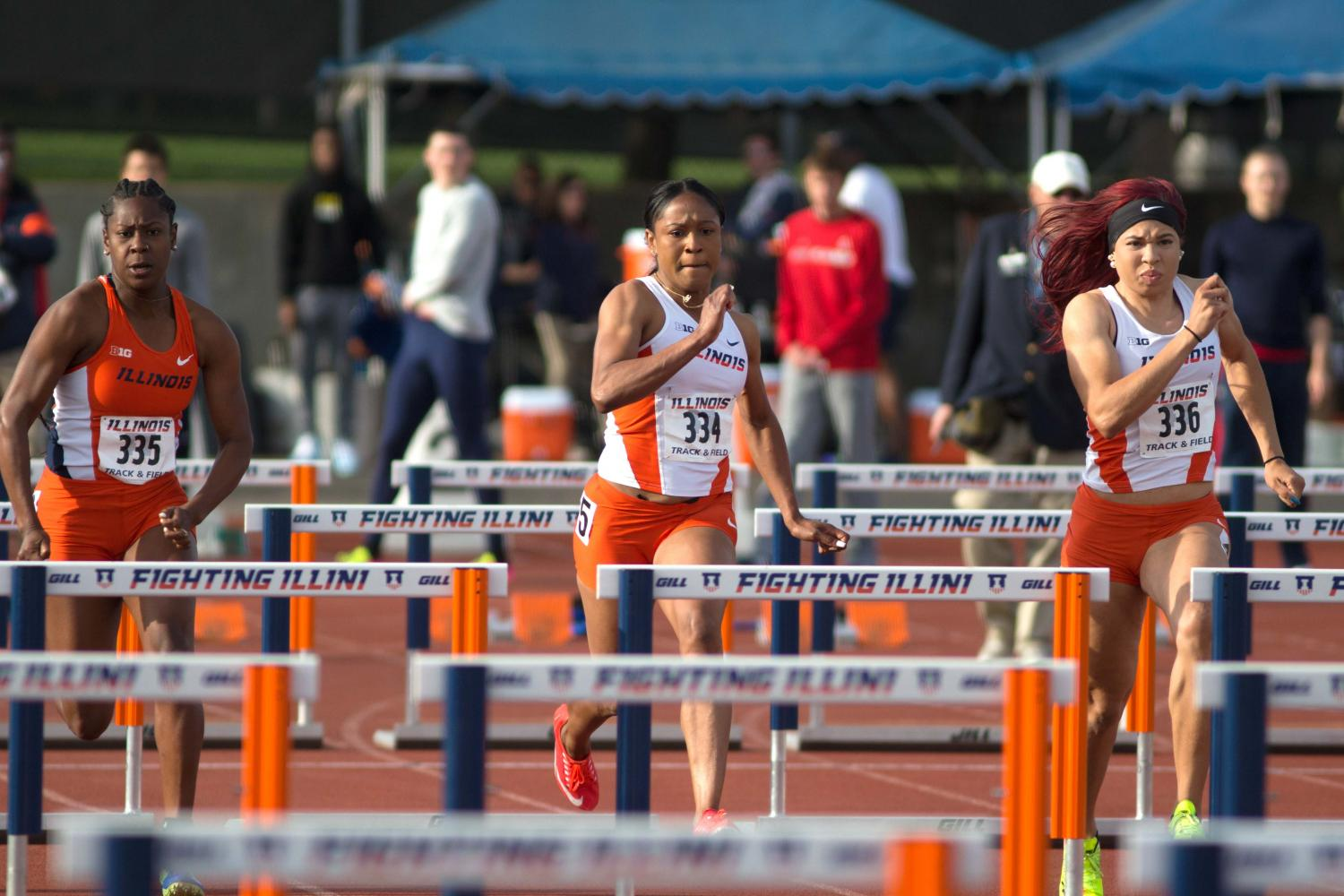 Kortni+Smyers-Jones+%28left%29%2C+Pedrya+Seymour+%28middle%29%2C+and+Jayla+Stewart+%28right%29+race+down+the+track+during+the+100+Meter+Hurdles+at+Illinois+Twilight+at+the+Illinois+Track+Field+on+Saturday%2C+Apr.+22.+Illini+swept+the+top+three+places+in+the+event+with+Seymour+in+first%2C+Stewart+in+second%2C+and+Smyers-Jones+in+third.+