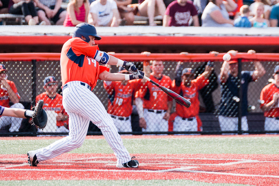 Illinois' Dan Rowbottom (19) hits a solo home run against Northwestern at Illinois Field on Saturday, April 15. The Illini lost 11-4.