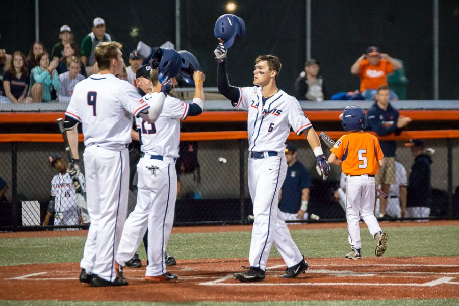 Illinois%27+Michael+Massey+%286%29+celebrates+with+his+teammates+after+hitting+a+home+run+against+Western+Michigan+at+Illinois+Field+on+April+18.+