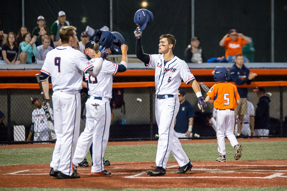 Illinois' Michael Massey (6) celebrates with his teammates after hitting a home run against Western Michigan at Illinois Field on April 18.