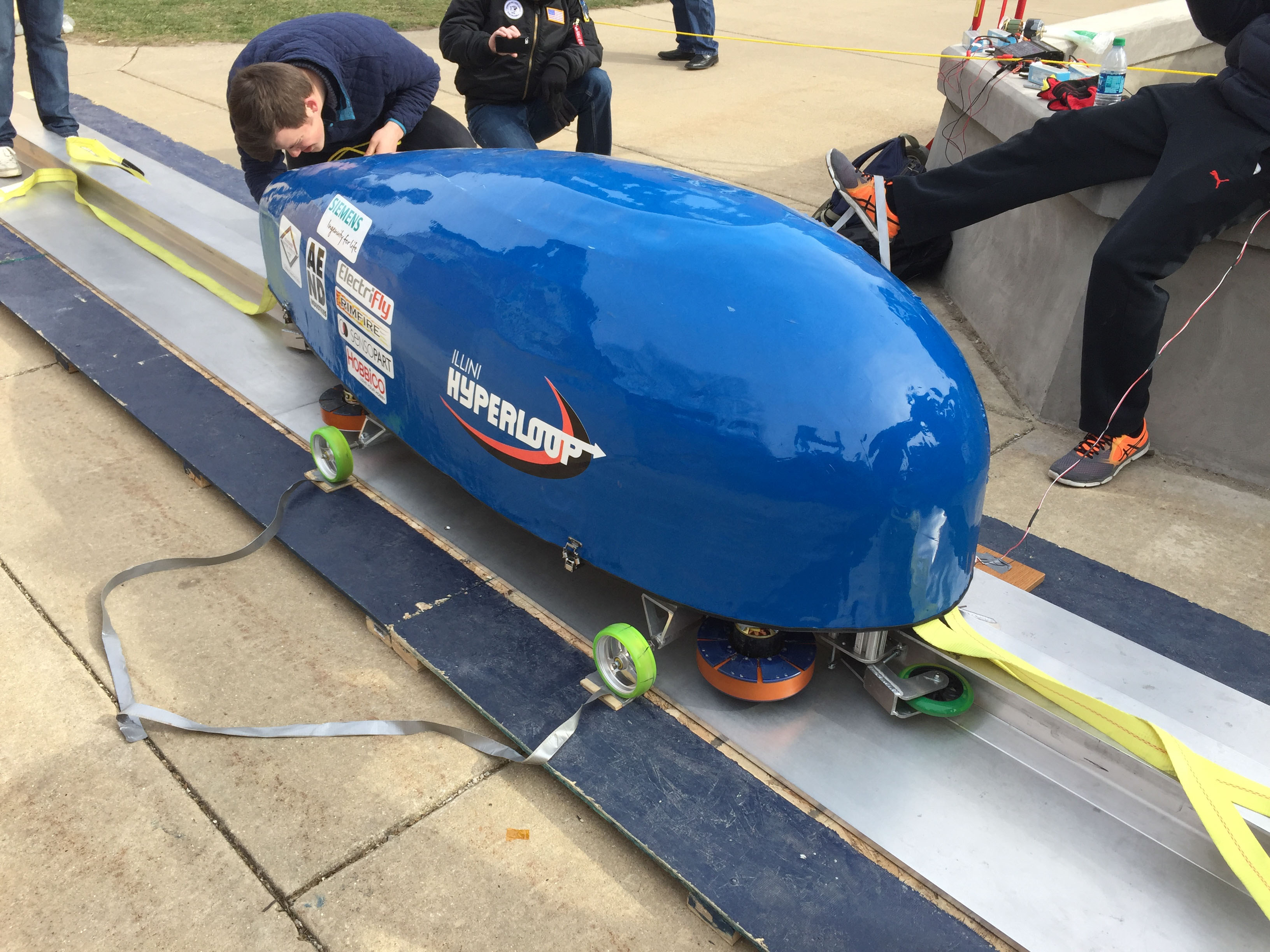 Illini Hyperloop members with the original pod they created for SpaceX's hyperloop competition. The team will be competing in the next SpaceX hyperloop competition later this year.