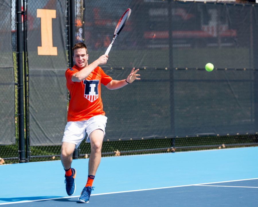 Illinois%27+Vuk+Budic+returns+the+ball+during+the+match+against+Iowa+at+Atkins+Tennis+Center+on+Saturday%2C+April+8.+