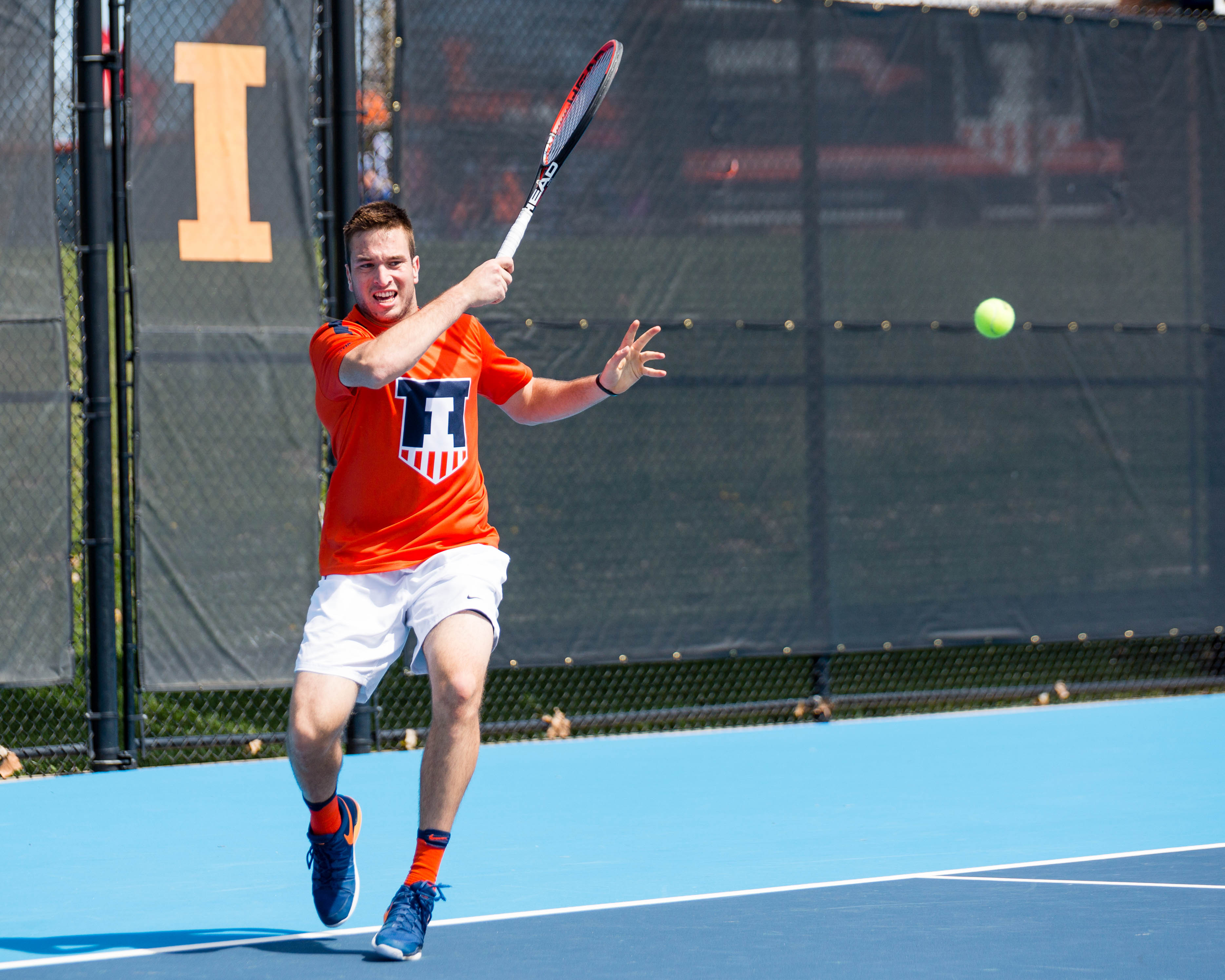 Illinois' Vuk Budic returns the ball during the match against Iowa at Atkins Tennis Center on Saturday, April 8.